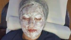 Photo of face with numbing cream applied